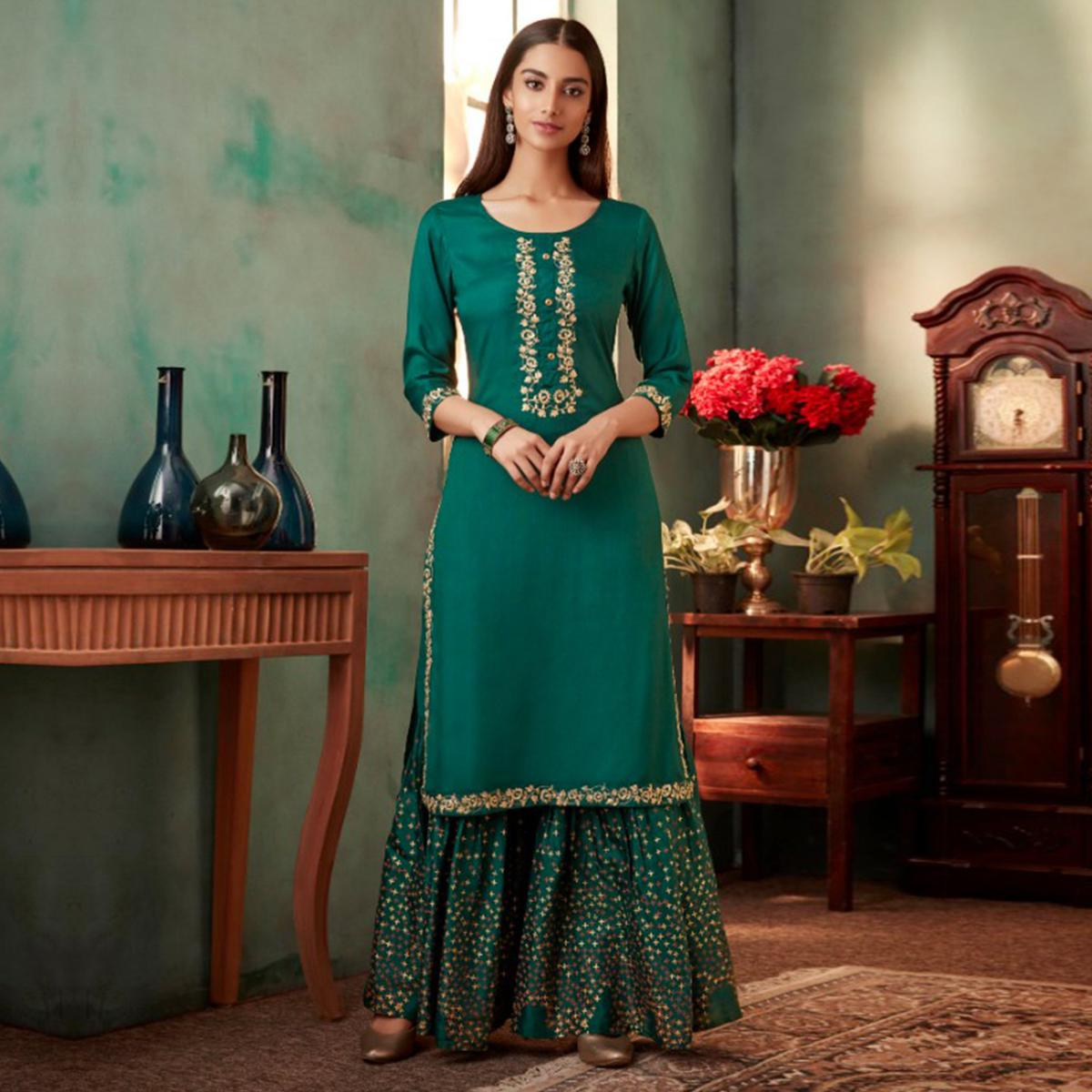 Mesmerising Dark Turquoise Green Colored Partywear Embroidered Muslin Crepe Silk Palazzo Suit