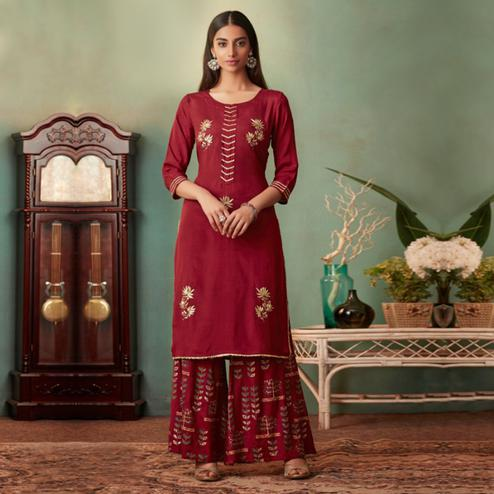 Impressive Red Colored Partywear Embroidered Muslin Crepe Silk Palazzo Suit