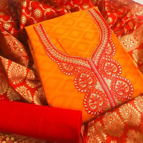 Energetic Orange Colored Partywear Embroidered Cotton Dress Material