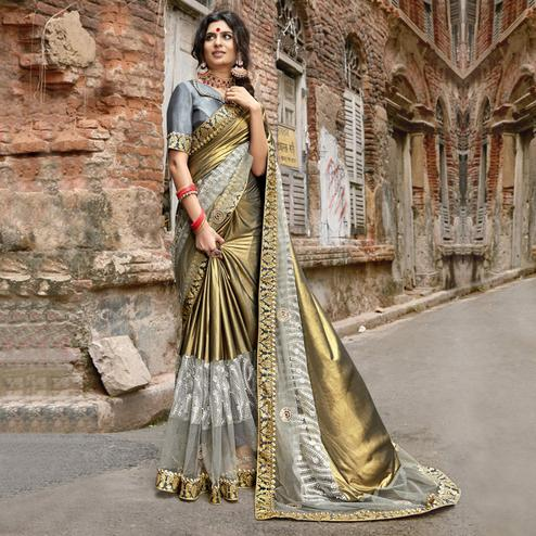 Delightful Golden Colored Partywear Embroidered Lycra Saree