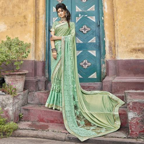 Innovative Mint Green Colored Partywear Embroidered Lycra Saree