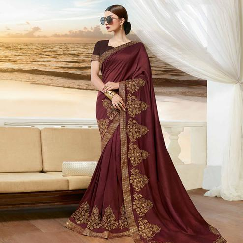 Flattering Brown Colored Partywear Embroidered Georgette Saree