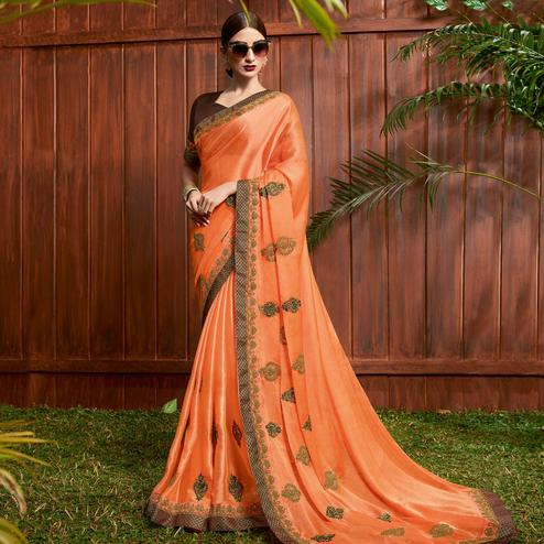 Marvellous Orange Colored Partywear Embroidered Georgette Saree