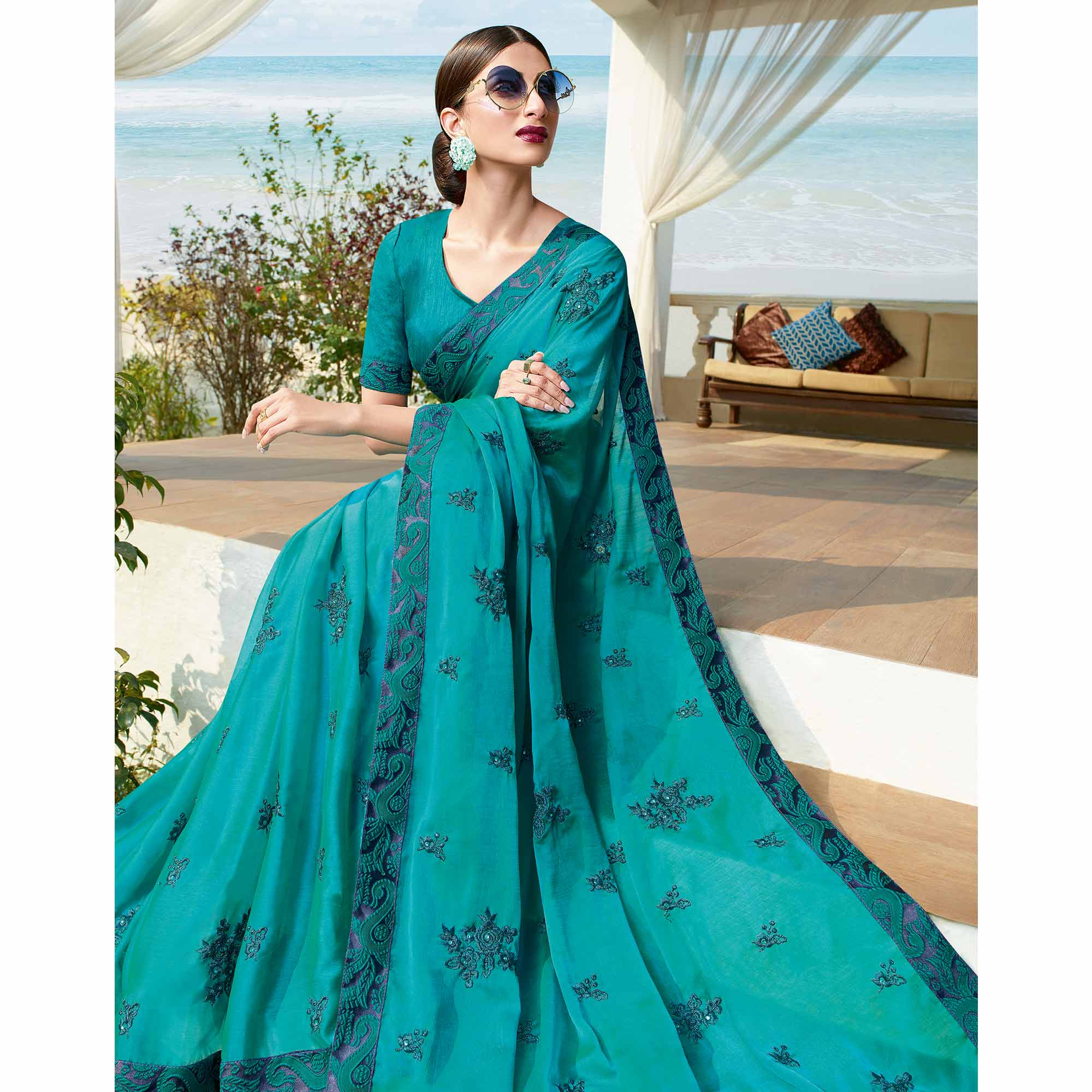 Flamboyant Rama Blue Colored Partywear Embroidered Georgette Saree