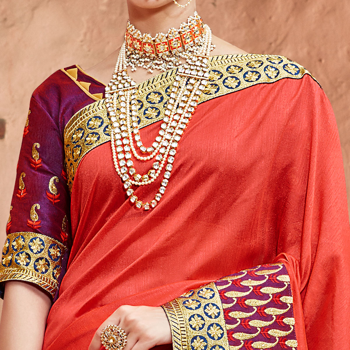 Engrossing Orange Colored Partywear Embroidered Georgette Saree