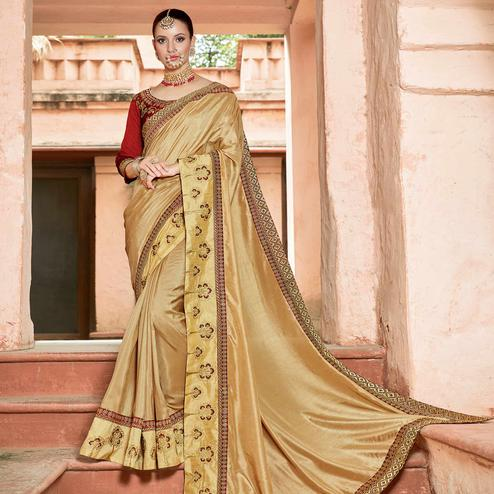 Innovative Beige Colored Partywear Embroidered Georgette Saree
