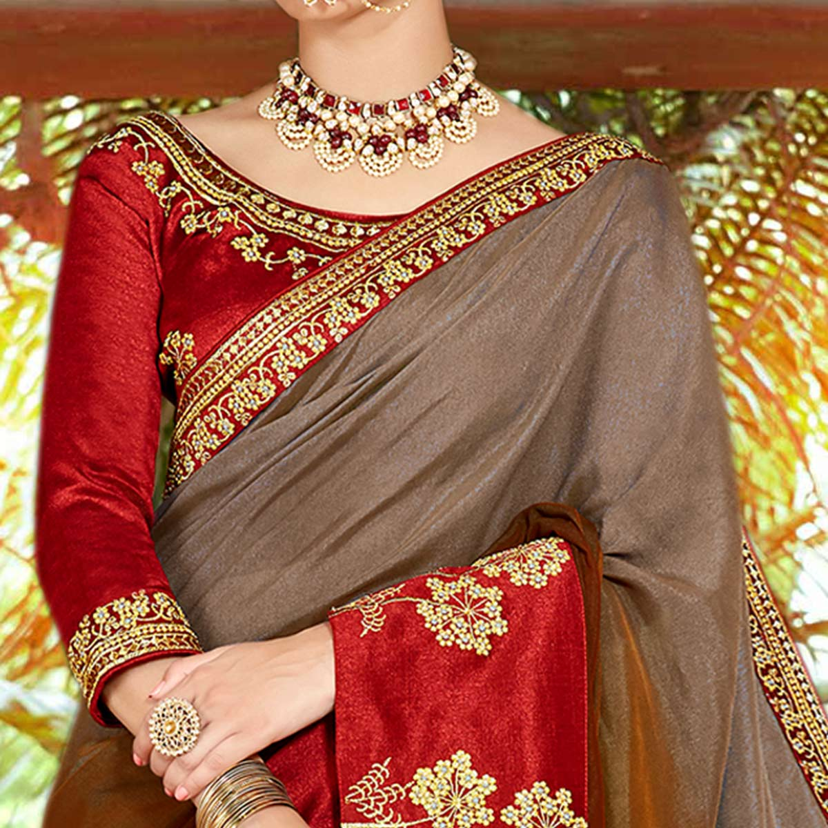 Eye-catching Brown Colored Partywear Embroidered Georgette Saree
