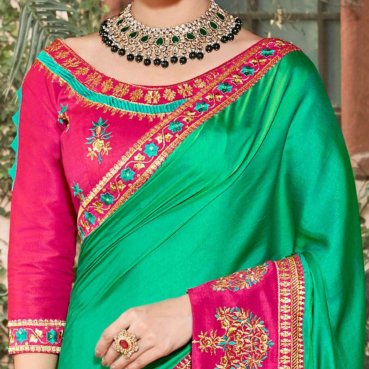 Amazing Turquoise Green Colored Partywear Embroidered Georgette Saree