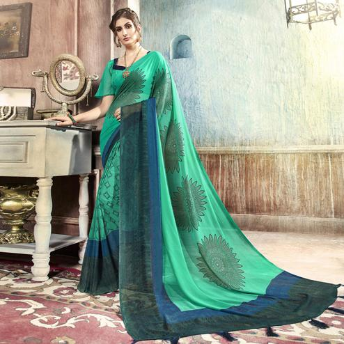 Majesty Turquoise Green Casual Printed Georgette Saree