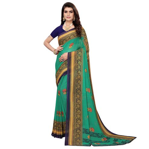 Adorable Dark Turquoise Green Colored Casual Wear Printed Georgette Saree