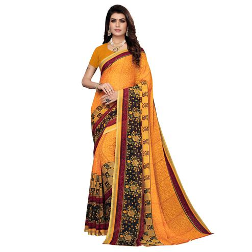 Delightful Pastel Orange Colored Casual Wear Printed Georgette Saree