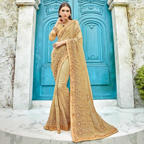 Jazzy Beige Colored Partywear Embroidered Georgette Saree