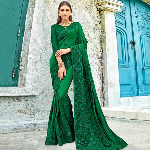 Delightful Dark Green Colored Partywear Embroidered Georgette Saree