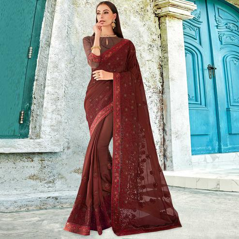 Pleasant Maroon Colored Partywear Embroidered Georgette Saree