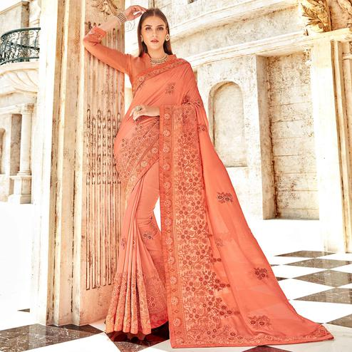 Opulent Peach Colored Partywear Embroidered Georgette Saree