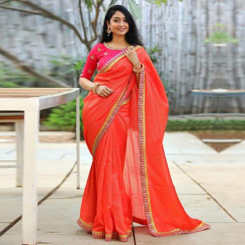 Alluring Orange Colored Partywear Embroidered Cotton Net Saree