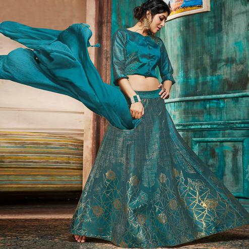 Gleaming Rama Green Colored Partywear Embroidery Banarasi Silk Lehenga Choli