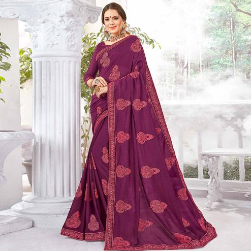 Prominent Purple Colored Partywear Embroidered Georgette Saree