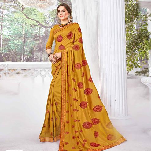 Arresting Mustard Yellow Colored Partywear Embroidered Georgette Saree