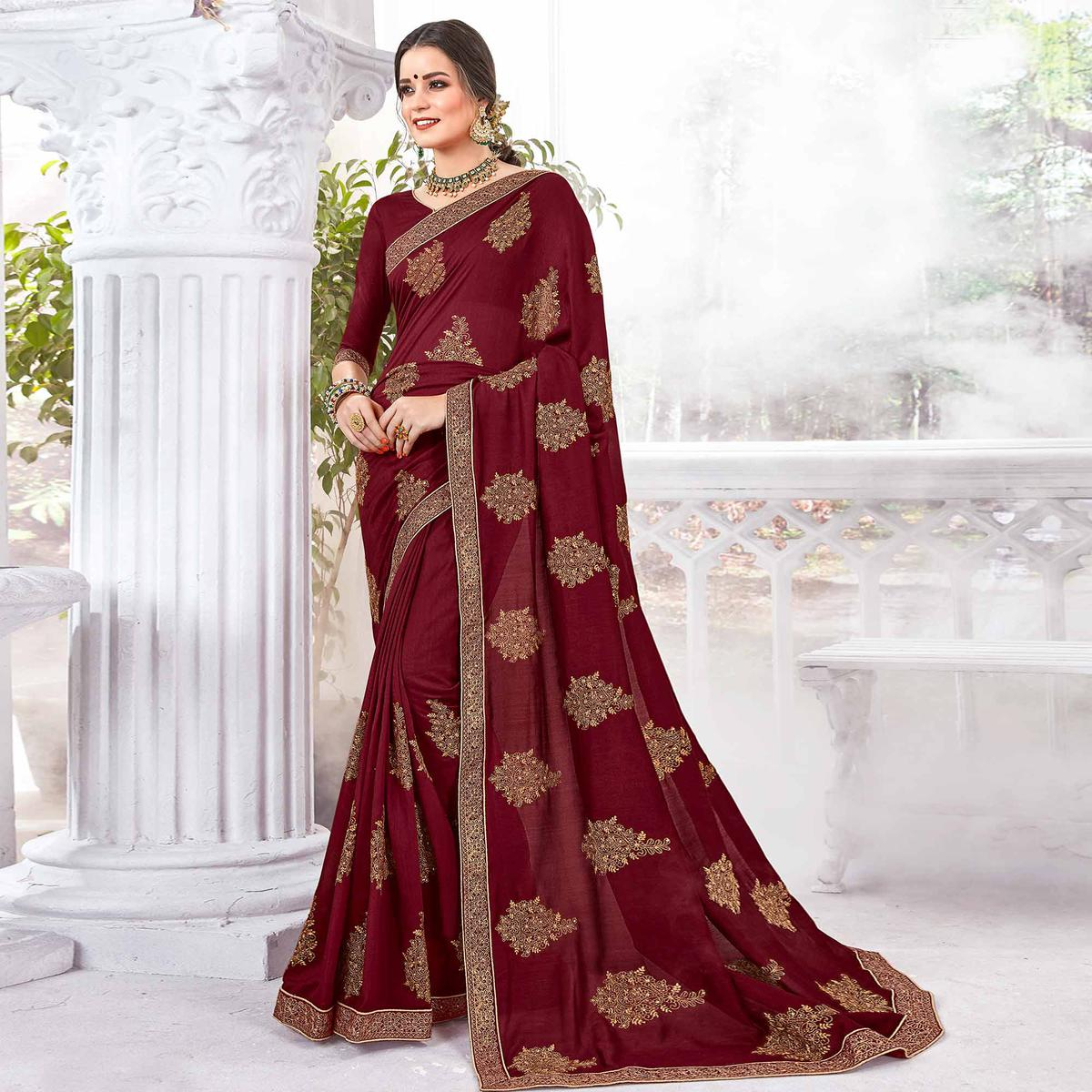 Glorious Maroon Colored Partywear Embroidered Georgette Saree