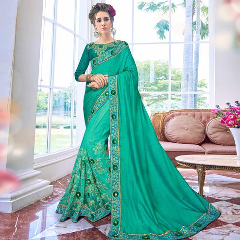 Demanding Turquoise Green Colored Partywear Embroidered Net-Art Silk Saree