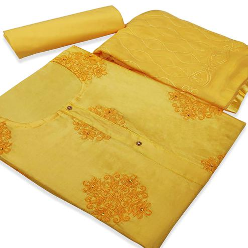 Flattering Yellow Colored Partywear Embroidered Cotton Silk Dress Material
