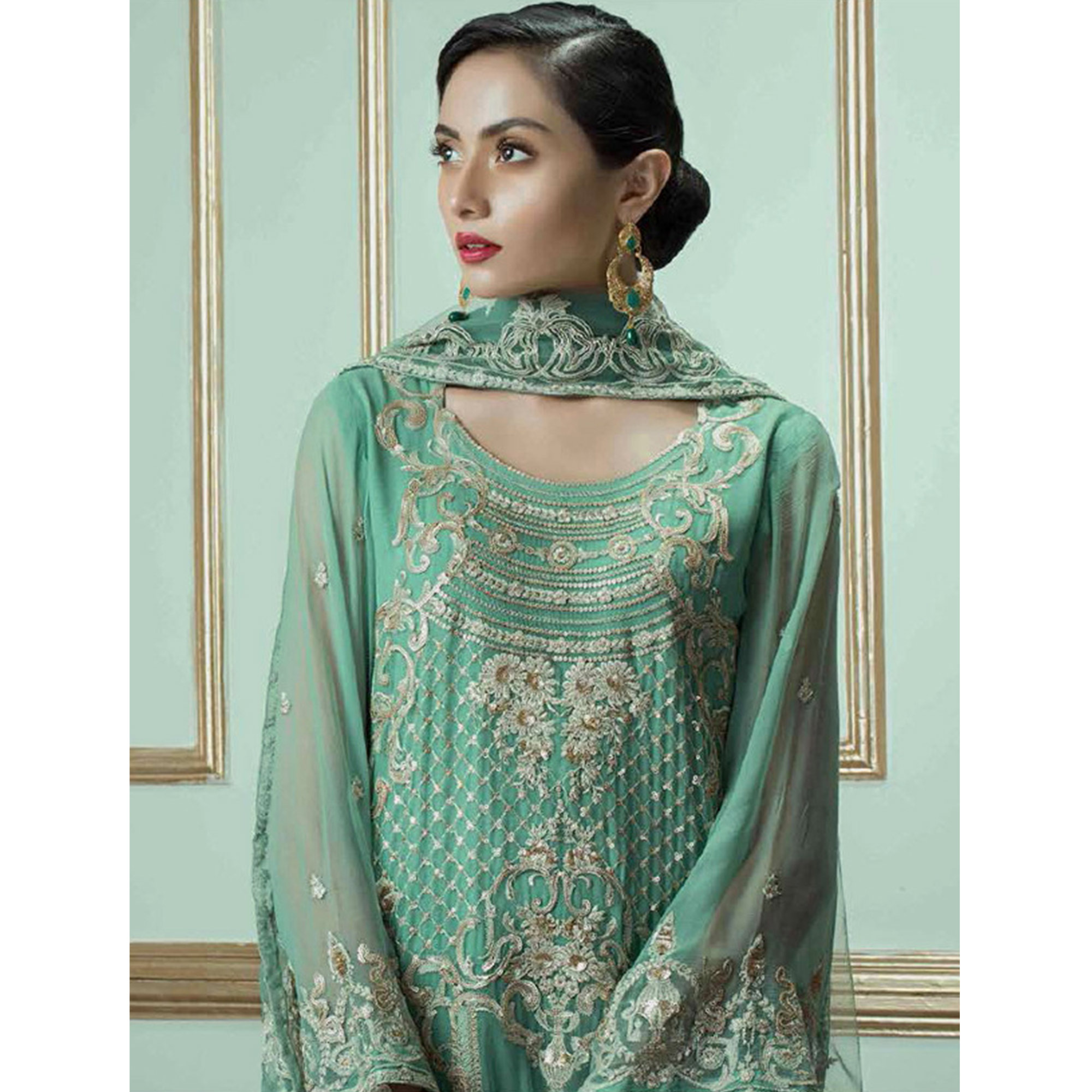 Intricate Turquoise Green Colored Partywear Embroidered Georgette Suit