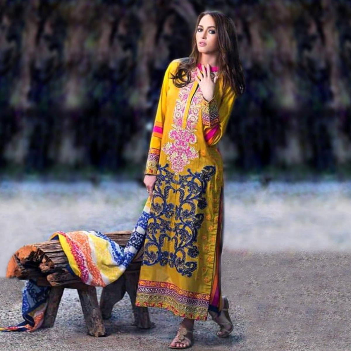 Exotic Yellow Colored Partywear Embroidered Cotton Suit