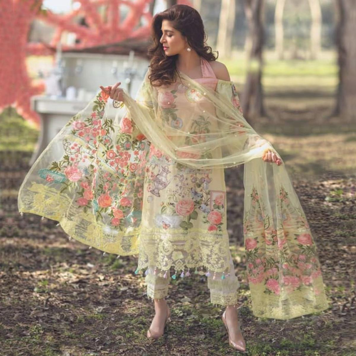 Pleasant Light Yellow Colored Partywear Embroidered Cotton Suit
