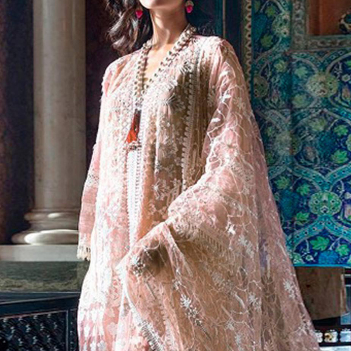 Glowing Pink Colored Partywear Embroidered Netted Suit