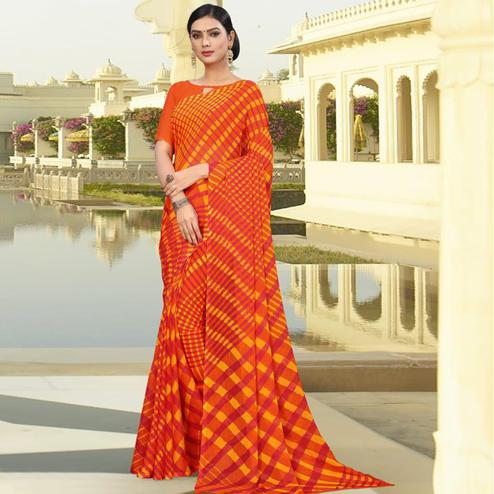 Breathtaking Orange Colored Casual Printed Chiffon Saree