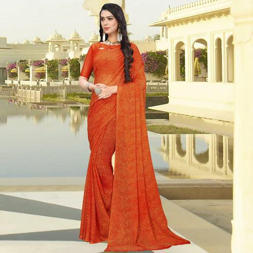 Surpassing Orange Colored Casual Leheriya Printed Chiffon Saree
