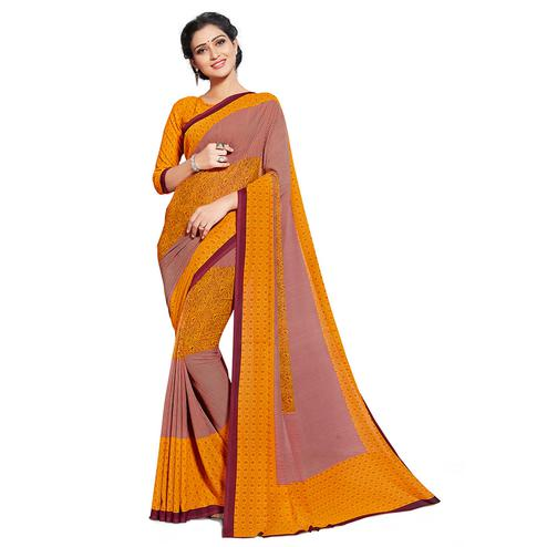 Captivating Orange Colored Casual Printed Georgette Saree
