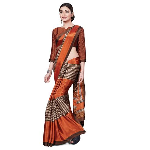Dazzling Rust Orange Colored Casual Wear Printed Crepe Saree