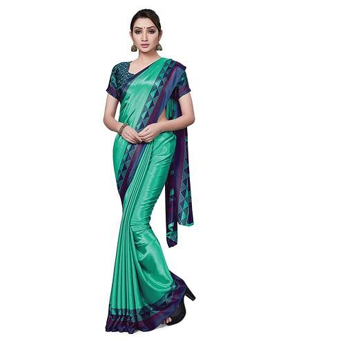 Elegant Aqua Green Colored Casual Wear Printed Crepe Saree