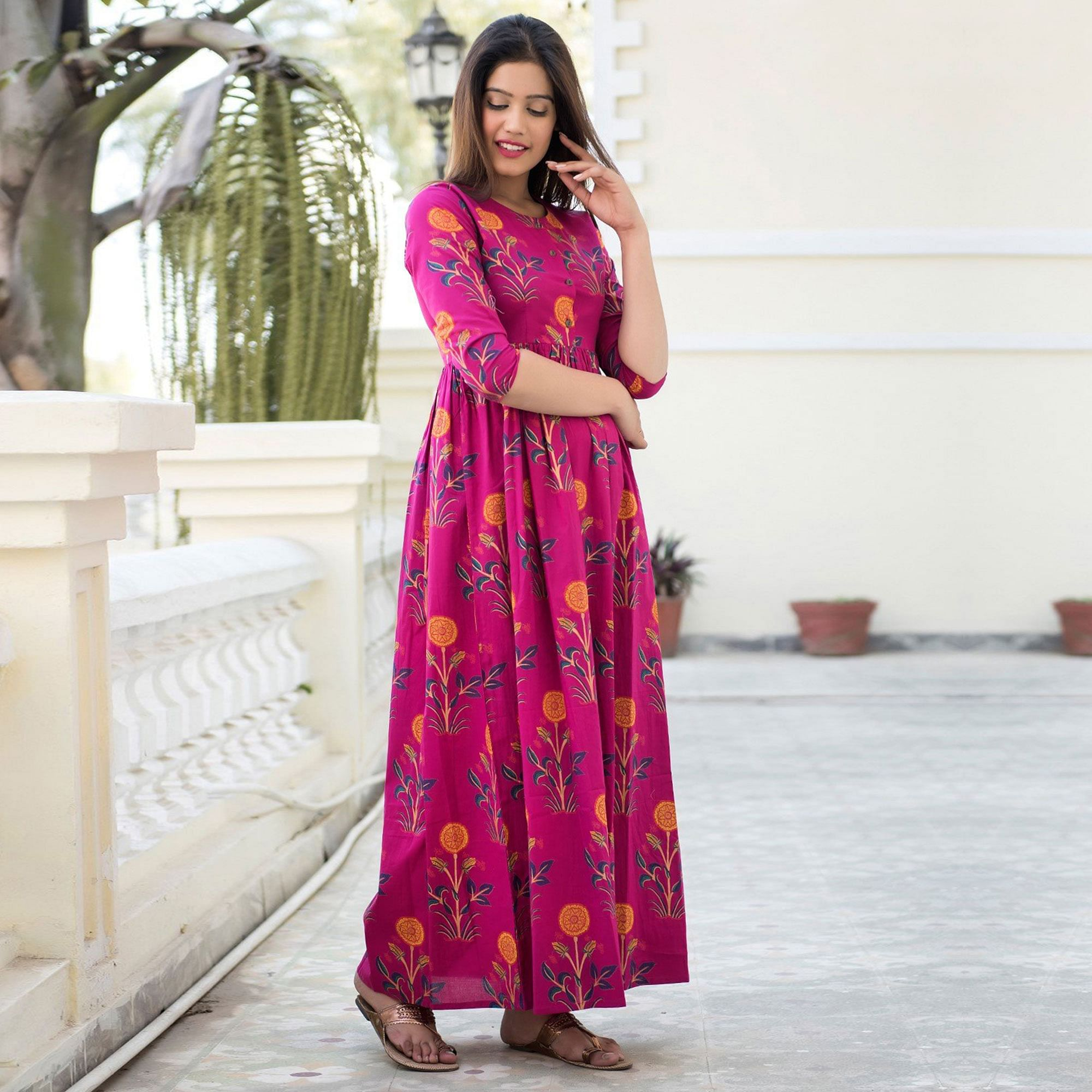 Prominent Rani Pink Colored Casual Printed Muslin Blend Gown