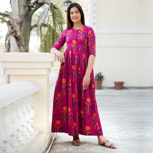 Prominent Rani Pink Colored Casual Printed Pure Muslin Gown