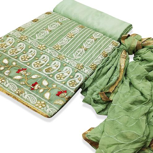 Innovative Green Colored Partywear Embroidered Chanderi Cotton Dress Material