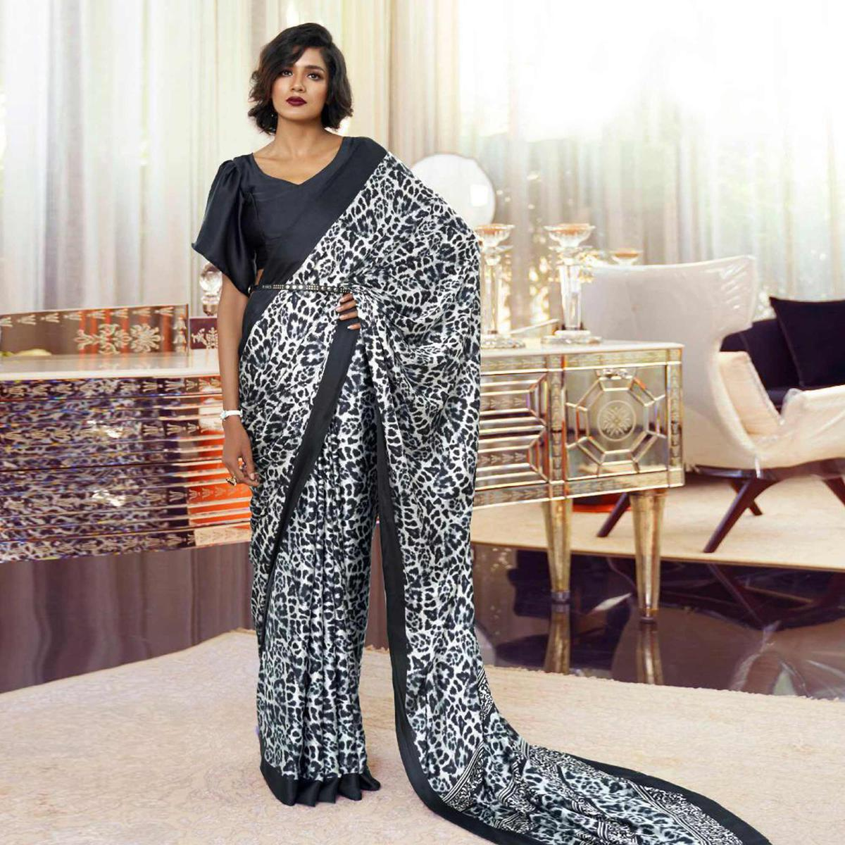 Prominent Black-White Colored Partywear Animal Printed Japan Satin-Crepe Saree