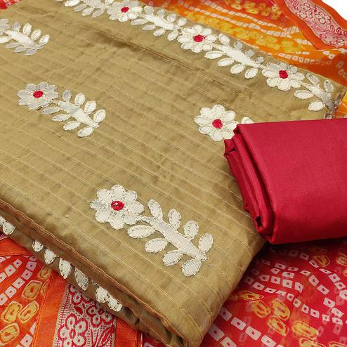Majesty Chiku Colored Partywear Embroidered Cotton Dress Material With Bandhani Dupatta