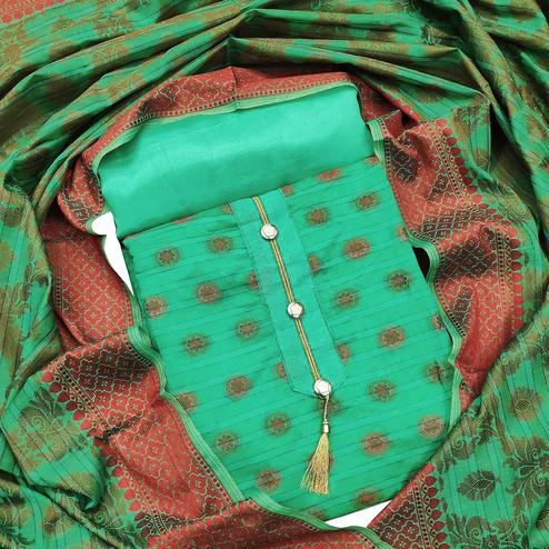 Gorgeous Turquoise Green Colored Festive Wear Woven Heavy Banarasi Silk Dress Material