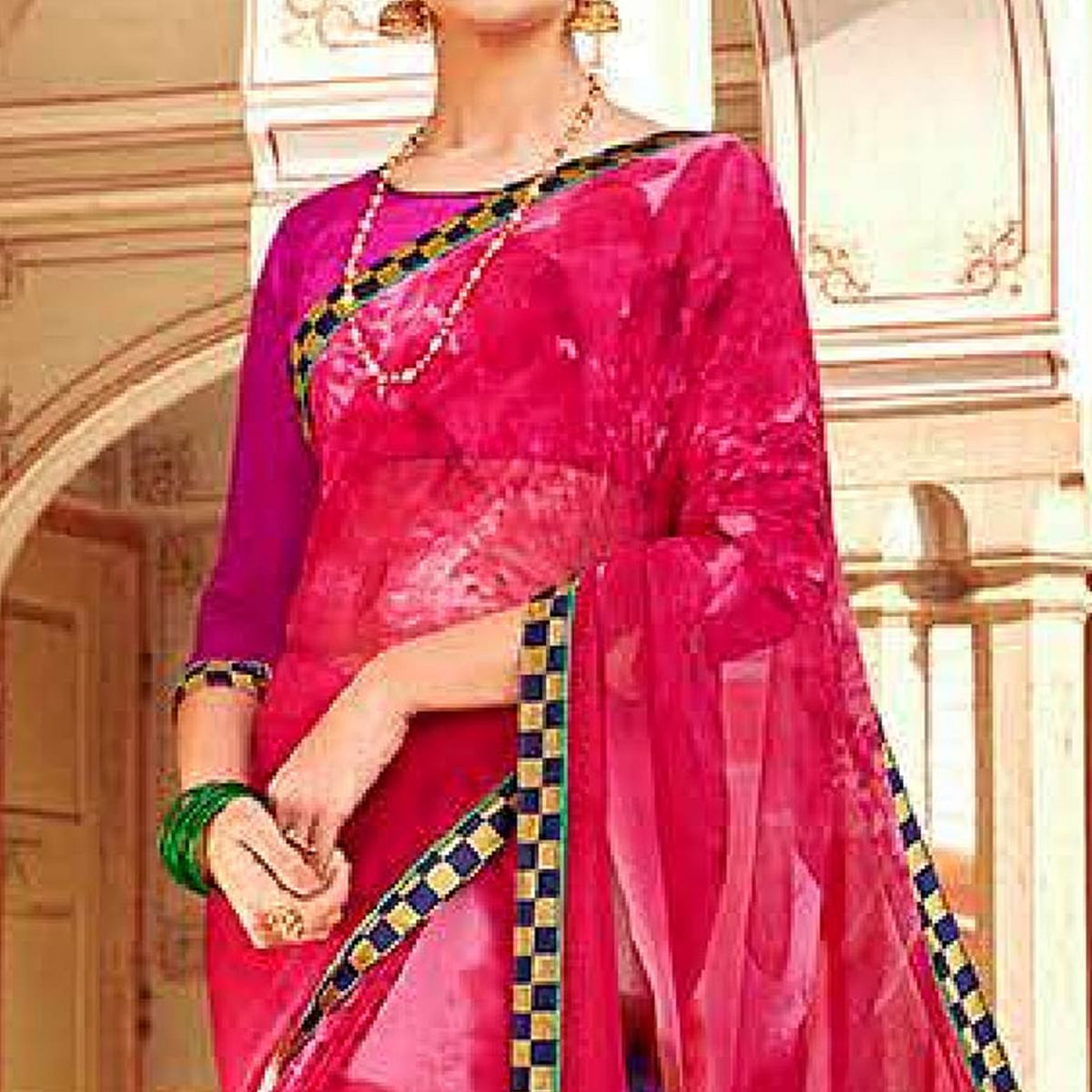 Exotic Pink Colored Casual Wear Printed Georgette Saree