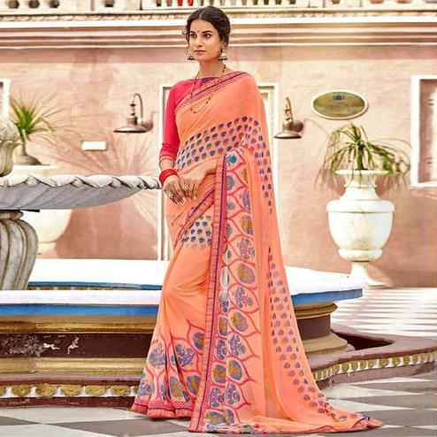 Glowing Peach Colored Casual Wear Floral Printed Georgette Saree