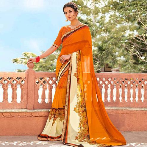 Refreshing Orange Colored Casual Wear Floral Printed Georgette Saree