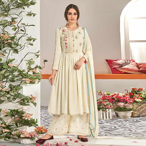 Glowing Cream Colored Partywear Floral Embroidered Stitched Muslin Cotton Palazzo Suit