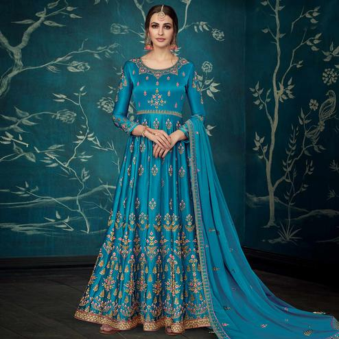 Breathtaking Teal Blue Colored Partywear Floral Embroidered Satin Silk Anarkali Suit