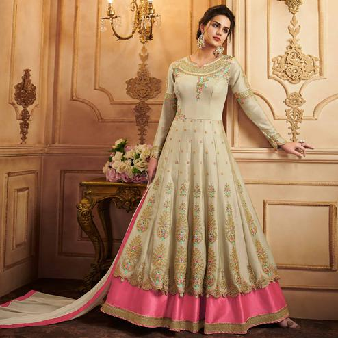 Stunning Chiku Colored Partywear Embroidered Silk Anarkali Suit