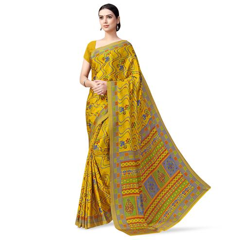 Charming Yellow Colored Casual Printed Crepe Saree