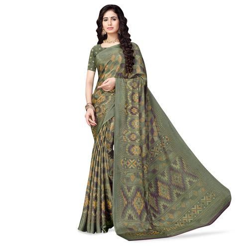 Exclusive Dark Olive Green Colored Casual Printed Crepe Saree