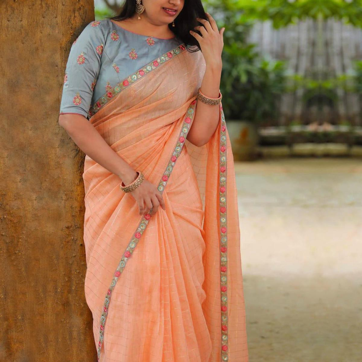 Desiring Peach Colored Partywear Embroidered Cotton Saree